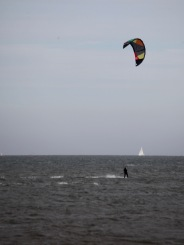 Wind surfer and yacht
