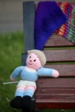 Knitted boy on bench