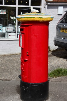 Knitted seagull on pillar box