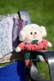 Knitted elderly woman on bench