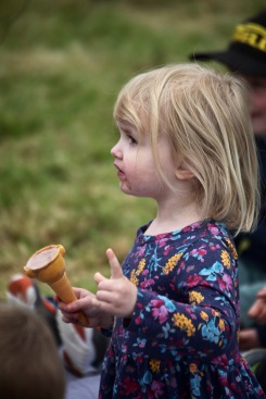 Child with ice cream watching Punch and Judy