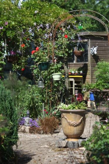 Urn, garden shed, wisteria arbour