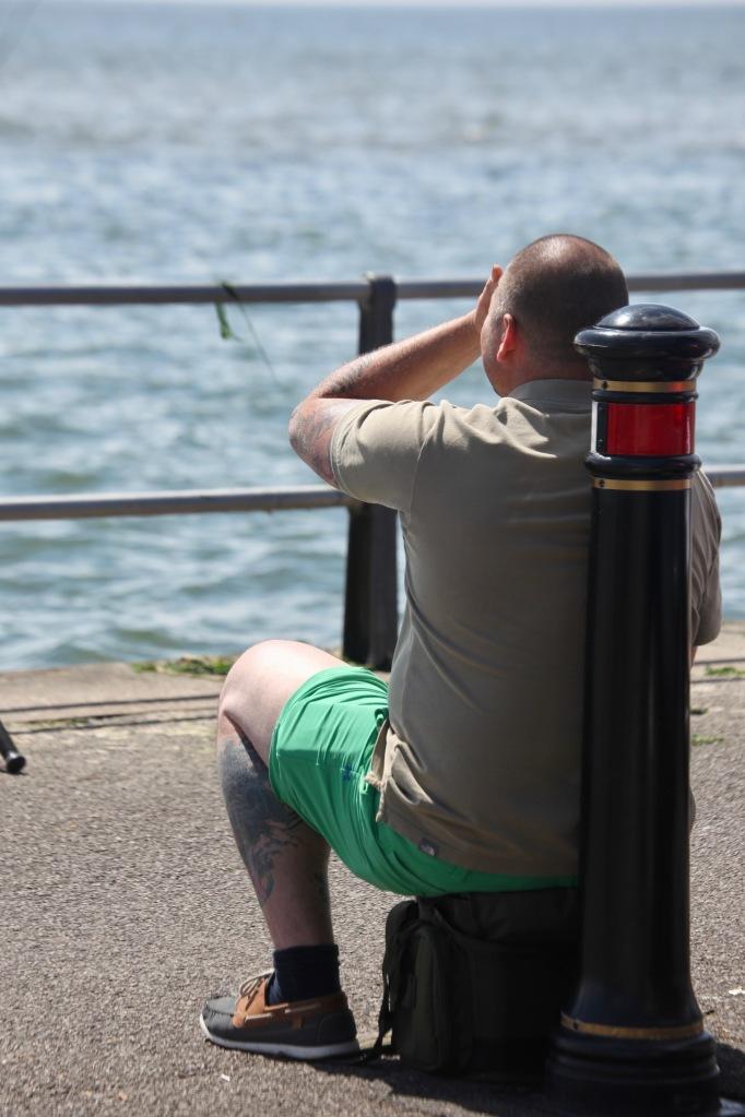 Man watching sea and shading eyes