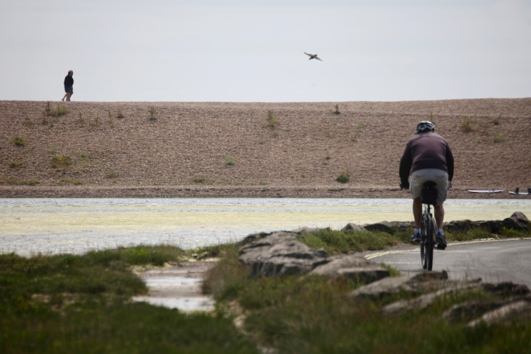 Cyclist, figures on Hurst Spit