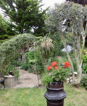 Garden view from grass patch through gazebo