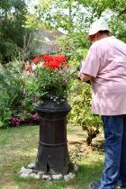 Jackie watering chimney planting