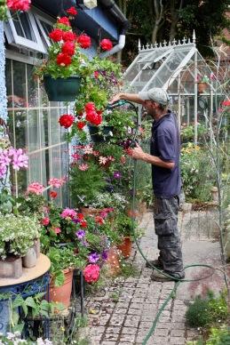 Daryl watering hanging baskets
