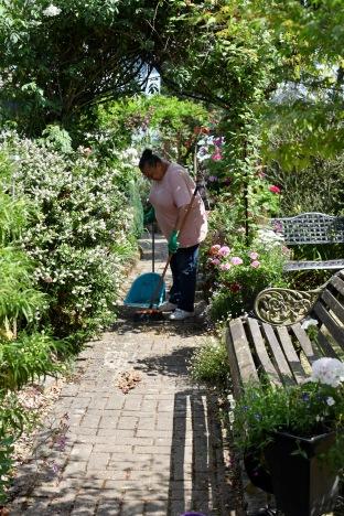 Jackie sweeping Brick Path