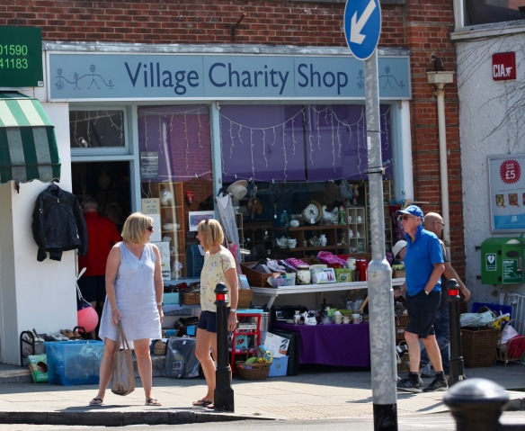 Conversation outside Village Charity Shop