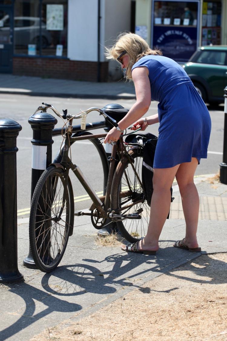 Cyclist tying up bike