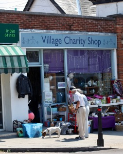 Couple with terrier outside Village Charity Shop
