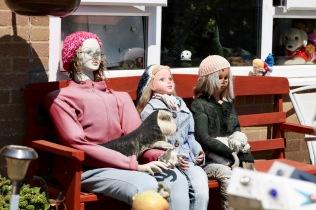 Figures on bench in Garden of Delights