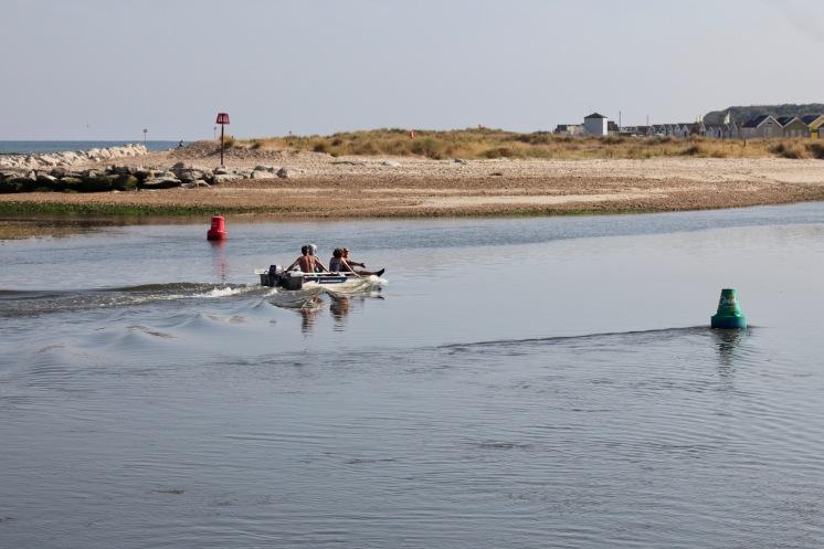 Boat going through buoys