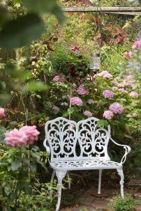 White bench corner of Rose Garden