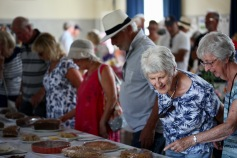 Visitors admiring cakes