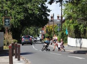 Women and children crossing road