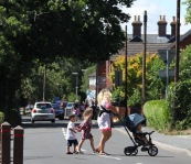 Woman crossing road with children
