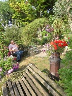 Jackie contemplating garden across grass patch