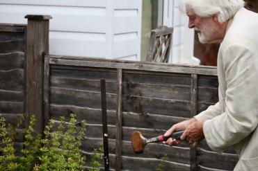 Derrick hammering stake
