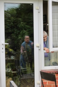Mum at window, Jackie's reflection