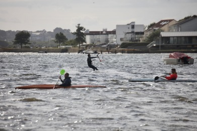 Kayakers and kite surfer