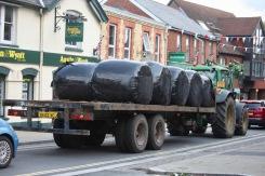 Tractor towing hay bales
