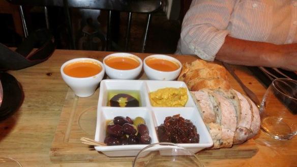 Bread board and dips; tomato soup