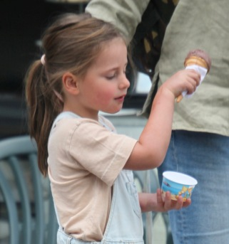 Girl with ice cream on arm