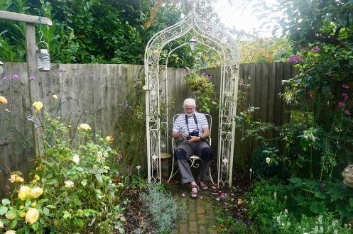 Derrick in Rose Garden by Helen K
