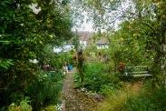 Gardenscape with Brick Path by Helen K