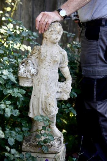 Derrick resting on Summer sculpture