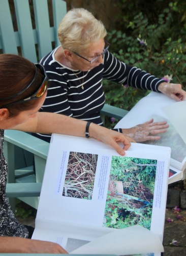 Pauline and Jo examining Garden Albums