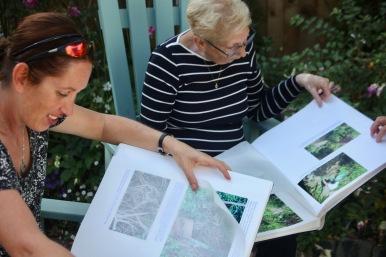 Jo and Pauline examining Garden Albums