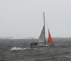 Red sailed yacht