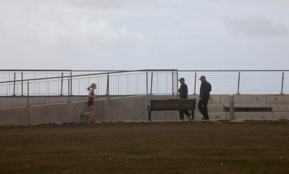 Runner approaching walkers