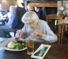 Mum eating chicken and ham pie meal