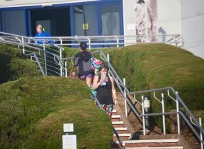 Women passing on steps
