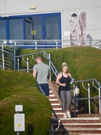 Man and woman passing on steps