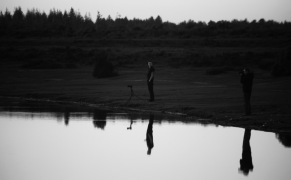 Photographers reflected in silhouette