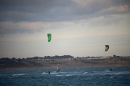 Kite surfers and sailboarder