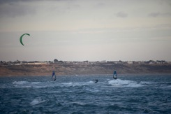 Kite surfer and sailboarders